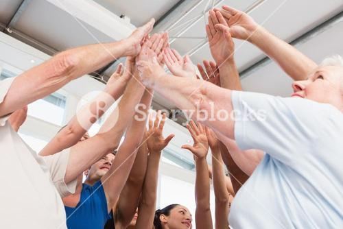 Cheerful friends with hands raised