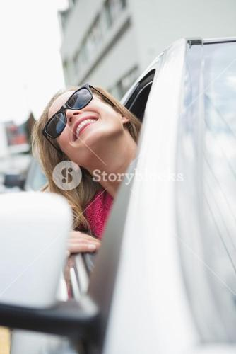 Happy woman in the drivers seat