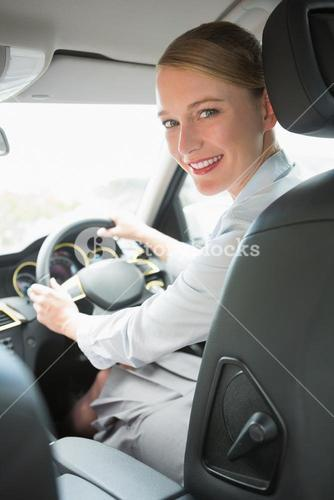Young smiling businesswoman looking at camera