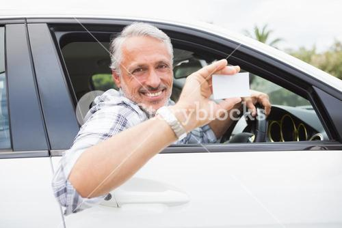 Man smiling and holding card