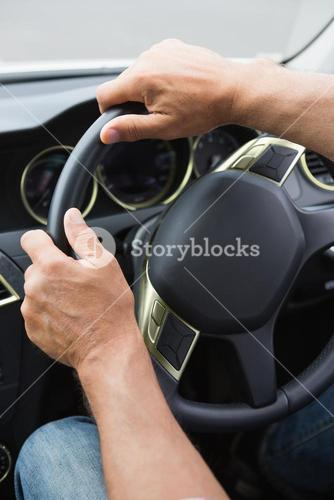 Close up of man holding his wheel