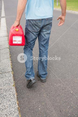 Man bringing petrol canister to a broken down car
