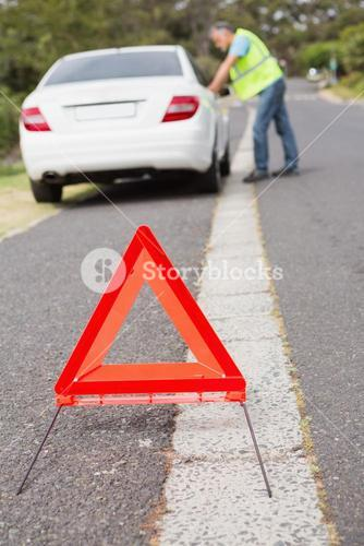 Close up on triangle warning sign