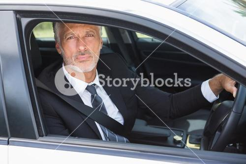 Thoughtful businessman in the drivers seat