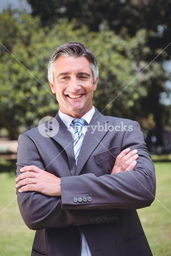 Businessman smiling in the park