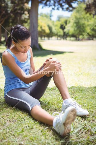 Fit woman with injured knee