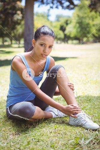 Fit woman with injured ankle