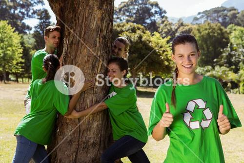 Environmental activists hugging a tree in the park