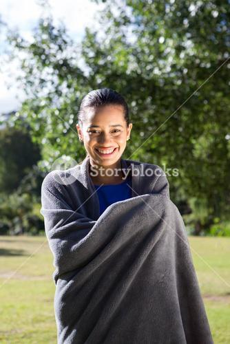 Pretty woman wrapped in blanket