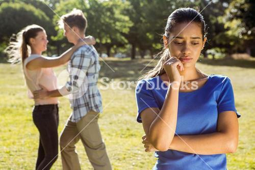 Man being unfaithful in the park
