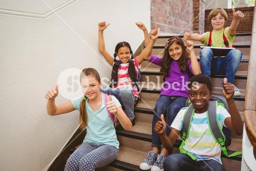 Children sitting on stairs in school