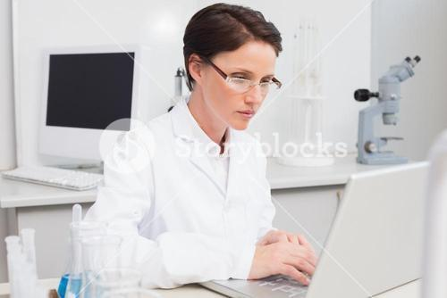 Scientist working attentively with laptop