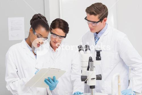 Scientists taking notes