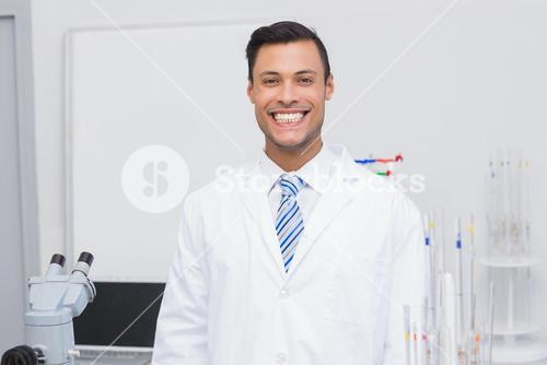 Happy scientist smiling at camera