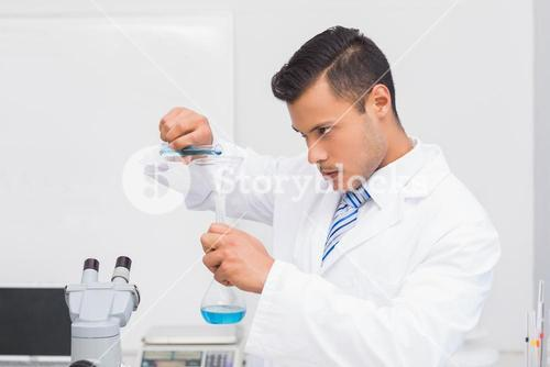 Serious scientist doing tube tests
