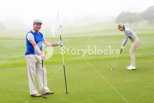 Golfing couple on the golf course