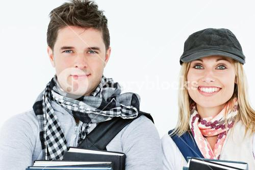 Portraits of two students holding books and smiling at the camera