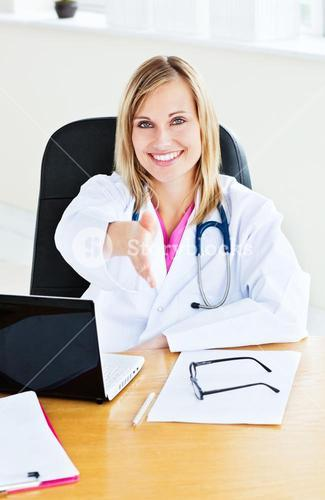 Joyful female doctor ready to shake hands with a patient