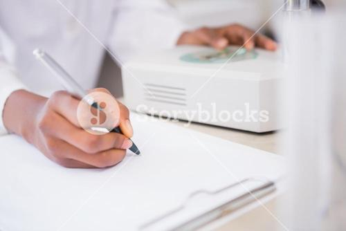 Scientist taking notes