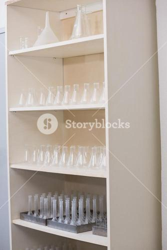 Storage unit with test tubes and beakers
