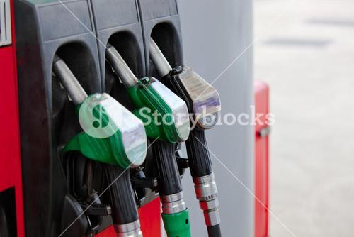Close up of a gasoline pumps nozzles in a petrol station