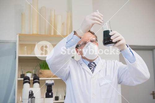 Scientist doing experimentations in flask