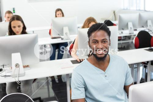 Smiling students in computer class
