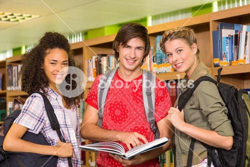 College students reading book in library