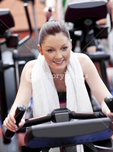 Portrait of a positive woman doing exercises in a sport centre