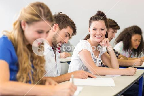 Students writing notes in classroom