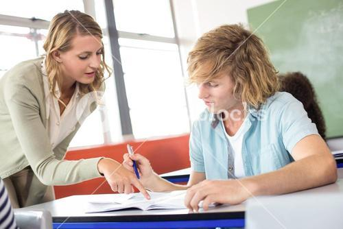 Teacher helping student in class