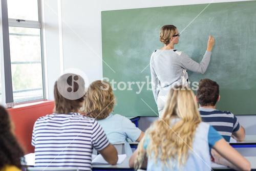 Teacher teaching students in class