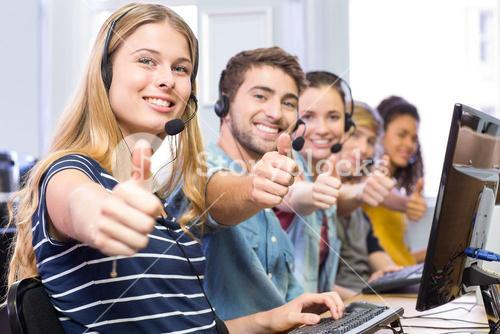Students gesturing thumbs up in computer class