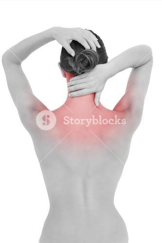 Rear view of a topless woman suffering from neck ache