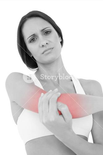 Portrait of a fit young woman with elbow pain