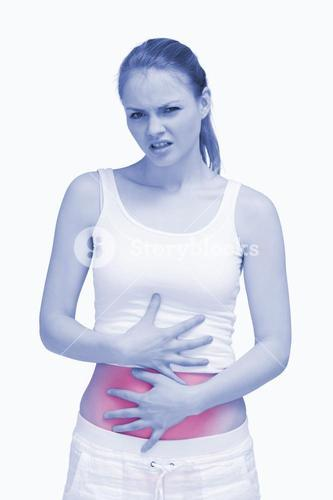 Suffering woman placing her hands on her stomach