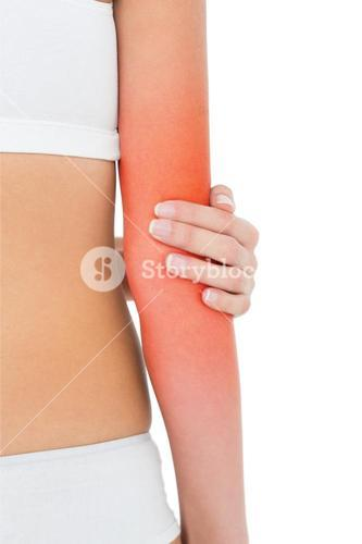 Closeup mid section of a fit woman with elbow pain