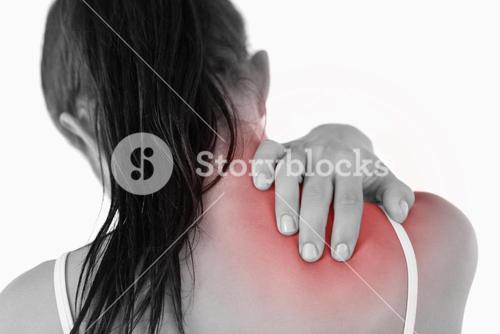 Back view of young woman with neck pain
