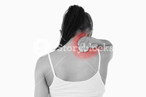 Back view of woman with pain in her neck