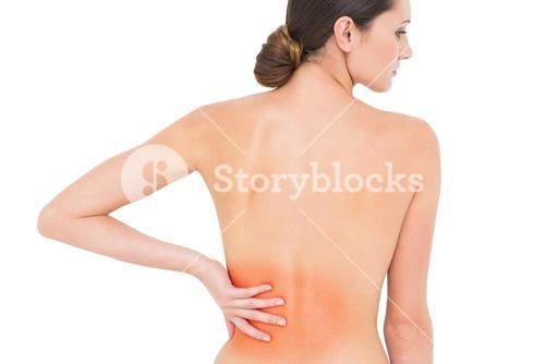 Rear view of a fit topless woman with back pain