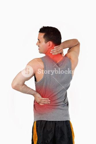 Portrait of a sports man having a back pain