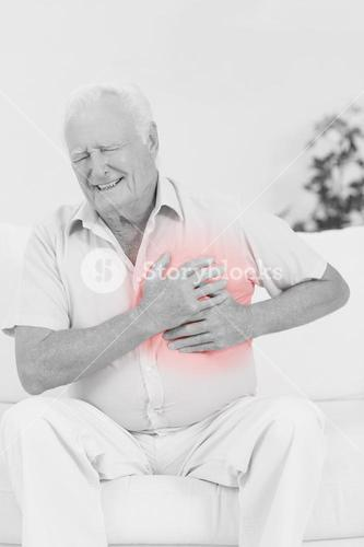 Aged man suffering with heart pain