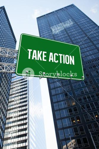 Take action against low angle view of skyscrapers