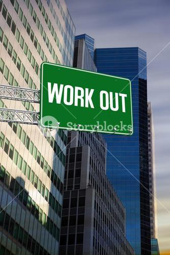Work out against low angle view of skyscrapers