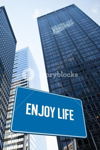 Enjoy life against low angle view of skyscrapers