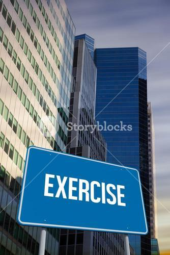 Exercise against low angle view of skyscrapers