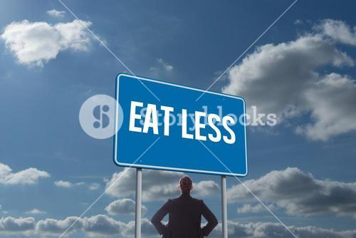Eat less against sky and clouds