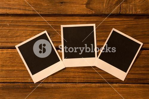 Instant photos on wooden floor