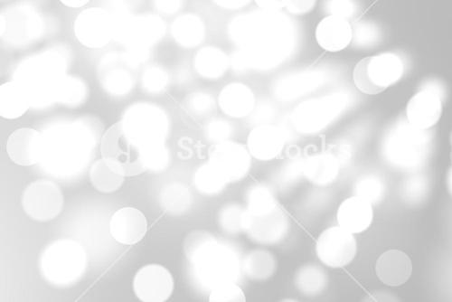 Light circles on grey background