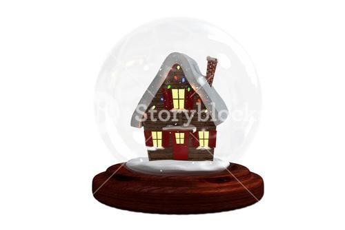 Christmas cottage in snow globe